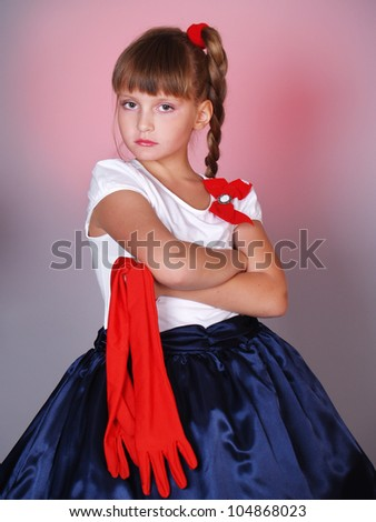 The offended beautiful little girl with red gloves - stock photo