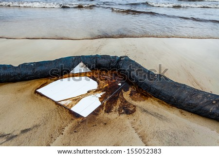 The oil absorb pater was used for absorb the crude oil on oil spill accident on Ao Prao Beach at Samet island on July 31,2013 in Rayong,Thailand  - stock photo