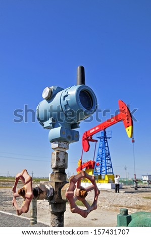 The oil drill pipes and valves  - stock photo