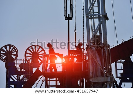 The oil workers in the job - stock photo