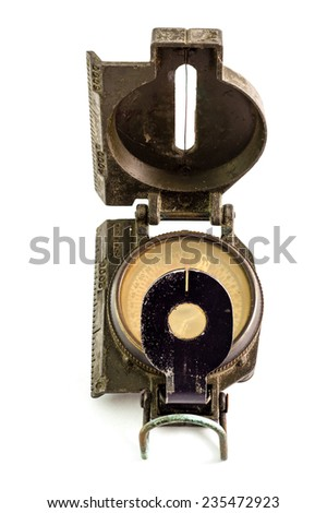 The old and dirty military compass on white - stock photo