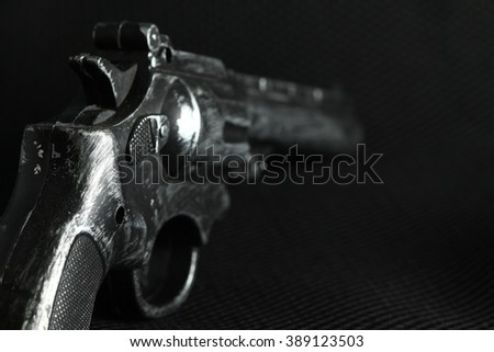 The old and dirty plastic toy gun represent the crime and weapon concept related idea. - stock photo