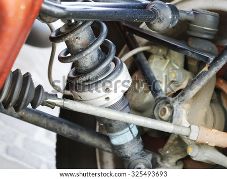 The old and dirty shock absorber cover with rust represent the car part. - stock photo