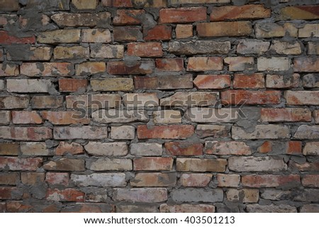 The old brick wall background building facade - stock photo