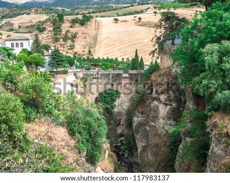 The Old Bridge in Ronda, Spain - stock photo