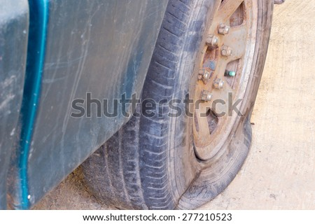 The old broken car rubber , leak rubber  of the green car  - stock photo