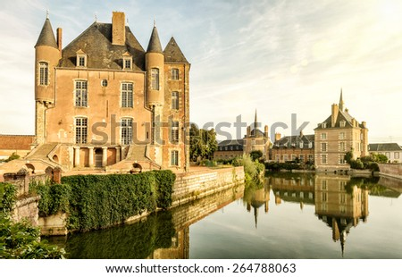 The old castle on the lake in the Loire Valley in France - stock photo