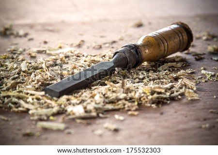the old chisel in wooden work shop - stock photo