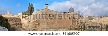 The Old City in Jerusalem with the Dome of the Rock overlooking. The southwest corner of the temple mount. - stock photo