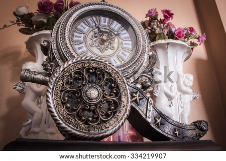 The old classic vintage clock - stock photo