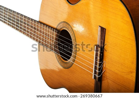 The old classical guitar on white background  - stock photo