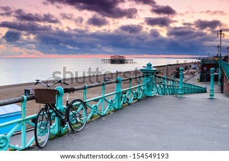 The old derelict West Pier in Brighton at sunset from the roadside. - stock photo