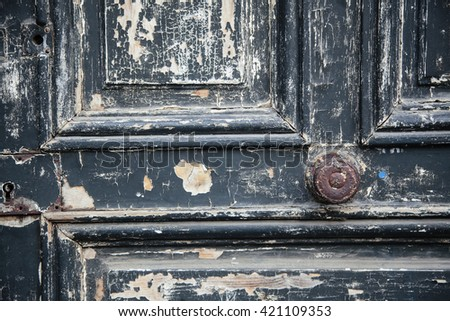 The Old Door with Cracked Paint Background closed with wood palets and vintage wall macro - stock photo