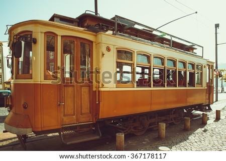 The old fashion Porto yellow streetcar. - stock photo