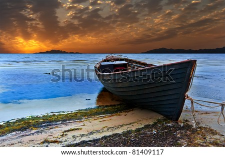The old fishing boat at sunset, Baltic Sea - stock photo