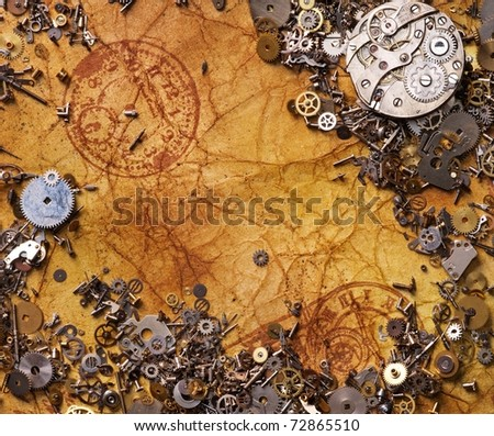 The old gears on the textured paper - stock photo