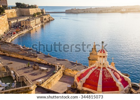 The old harbor of Valletta with church roof at sunrise - Valletta, Malta - stock photo