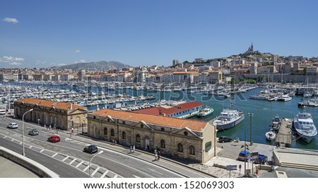 "The old harbor ""Vieux Port"" and the church ""Notre Dame de la Garde"" of Marseille in France - stock photo"
