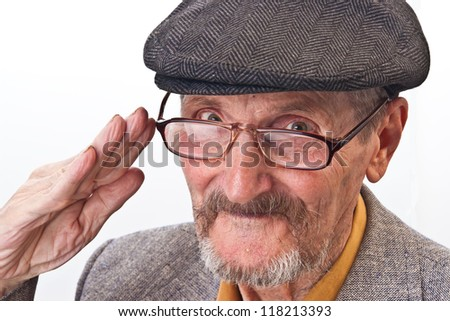 the old man with glasses and peaked cap - stock photo