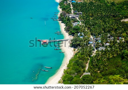 The Old marina or the pier or the port on the beach of fisherman living. Top view on the mountain Traditional fishing village is secluded and clear turquoise sea waters. On small Island, Thailand. - stock photo