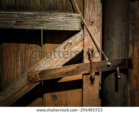 The old metal bolt is designed to close the gate.  - stock photo