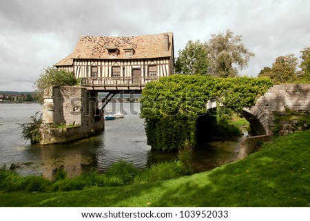 The old mill on medieval bridge in Vernon, Normandy - stock photo