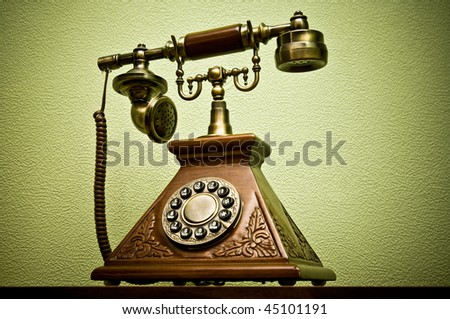 The old phone with disc dials on the background wallpaper - stock photo