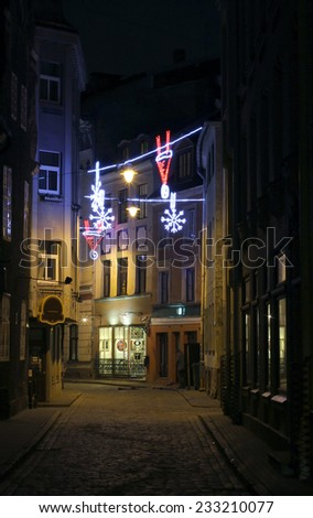 The old Riga street with christmas light decoration - stock photo