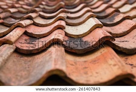 The old roof covered with orange tiles. Close up. - stock photo