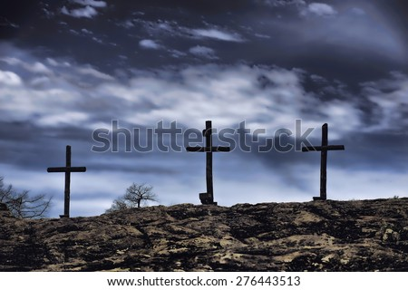 The old rugged wooden cross of the christian church. - stock photo