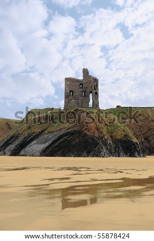 the old ruin of a castle in ballybunion overlooking the beach - stock photo