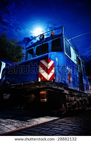 The old Soviet blue locomotive in the train yard - stock photo