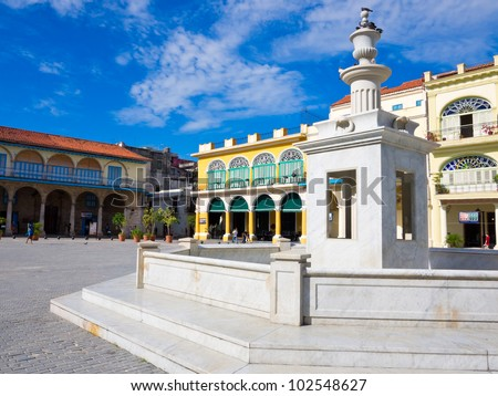 The Old Square with its white marble fountain, in spanish known as Plaza Vieja, a touristic landmark famous for its colonial architecture in Old Havana - stock photo