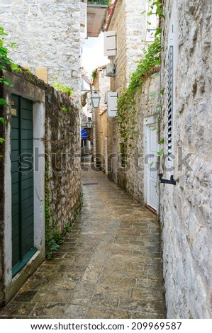 The old town-citadel of Budva consists of many narrow streets and lanes, full of souvenir shops, cafes, bars and medieval landmarks, Montenegro. - stock photo