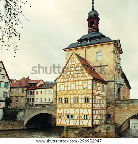 The Old Town Hall (1386) of Bamberg(Germany) was built in the middle of the Regnitz river, accessible by two bridges . The Old Town of Bamberg is listed as a UNESCO World Heritage. Square toned image - stock photo