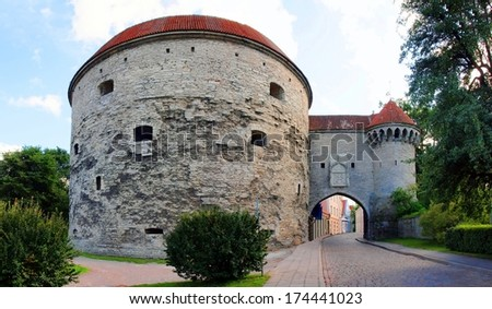 The old town Tallinn, Estonia. View of the Fat Margaret tower and st.Olav's Church. UNESCO World Heritage Site  - stock photo