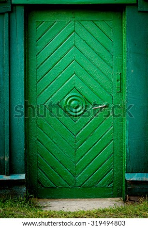 The old vintage wooden doors and fence, green colour - stock photo