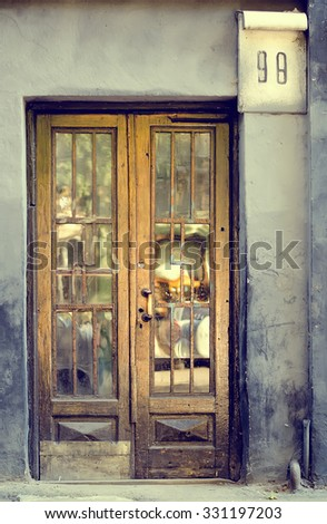 The old vintage wooden doors, grey colour - stock photo