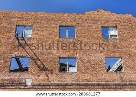 The old warehouse with a collapsed roof - stock photo