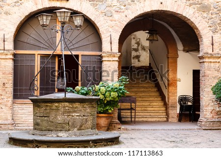 The Old Water Well in Montalcino, Tuscany, Italy - stock photo