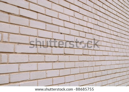 The old white brick wall for a background or structures. - stock photo