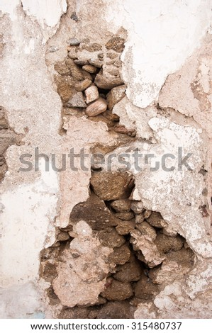 The old whitewashed walls of brick and stone. Background. - stock photo