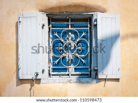 The Old window on wall background, Bayonne, France - stock photo