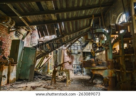 The old workshop in an abandoned factory. - stock photo