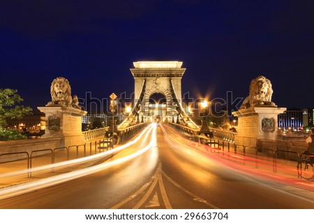 The oldest bridge in Budapest - Chain Bridge at night - stock photo