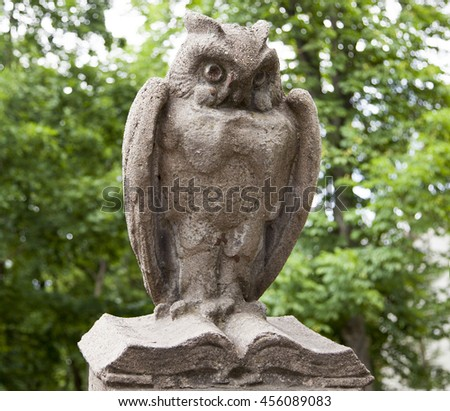 The one of fifty sculptures of owls that surrounds the College of Art in the city of Kaunas (Lithuania). - stock photo