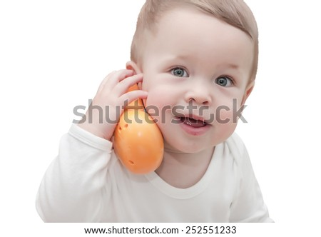 The one-year-old kid speaks by phone - stock photo