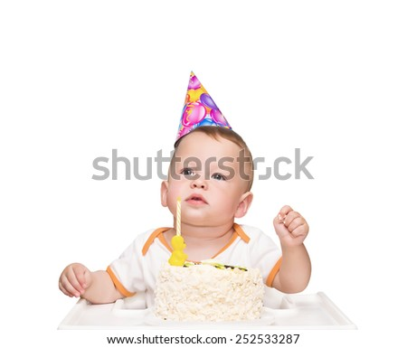 The one-year-old kid thinks of desire in birthday - stock photo