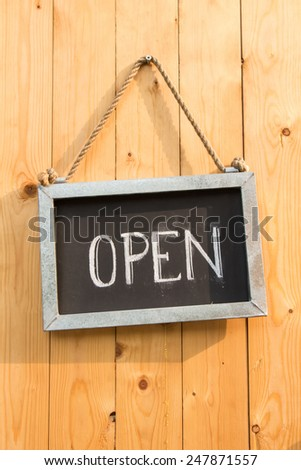 The open sign on a wooden door - stock photo