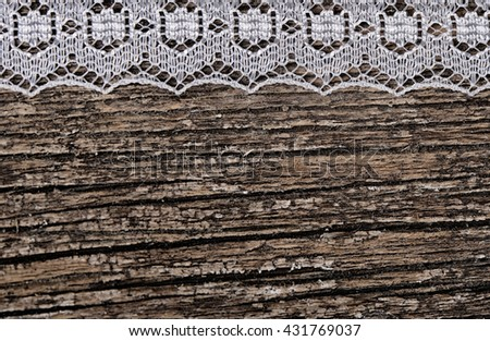 The openwork lace on a wooden background - stock photo